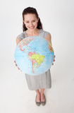 Businesswoman holding a terrestrial globe Royalty Free Stock Photography