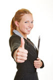 Businesswoman holding thumbs up Royalty Free Stock Photo