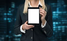 Businesswoman holding touch pad. Businesswoman holding blank touch pad Royalty Free Stock Image