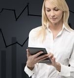 Businesswoman holding touch pad Stock Photos
