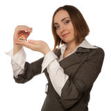 Businesswoman holding toy house in her hand Stock Images