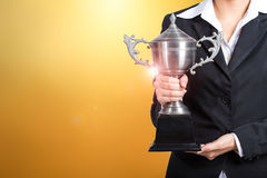 Businesswoman holding trophy award for success in business. gold Stock Photos