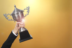 Businesswoman holding trophy award for success in business. gold Stock Images