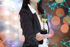 Businesswoman holding a trophy Royalty Free Stock Photography