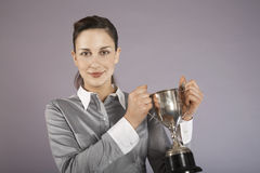 Businesswoman Holding Trophy Stock Photo