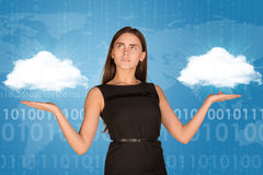 Businesswoman holding two white clouds, as if Stock Image