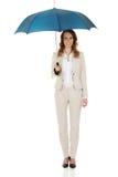 Businesswoman holding an umbrella. Stock Photography