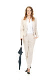 Businesswoman holding an umbrella. Royalty Free Stock Photo