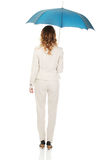Businesswoman holding an umbrella. Royalty Free Stock Photos