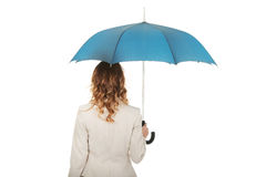 Businesswoman holding an umbrella. Stock Images