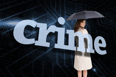 Businesswoman holding umbrella behind the word crime Stock Photography