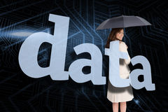 Businesswoman holding umbrella behind the word data Royalty Free Stock Photography