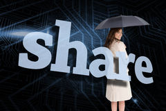 Businesswoman holding umbrella behind the word share Royalty Free Stock Photo