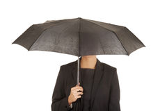 Businesswoman holding an umbrella. Stock Image