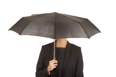 Businesswoman holding an umbrella. Stock Image