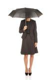 Businesswoman holding an umbrella. Stock Photo