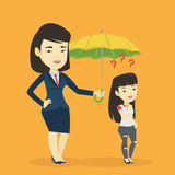 Businesswoman holding umbrella over woman. Royalty Free Stock Photography