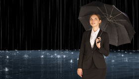 Businesswoman holding umbrella Royalty Free Stock Photography