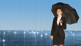 Businesswoman holding umbrella Stock Images