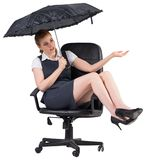 Businesswoman holding umbrella sitting on swivel chair. On white background Royalty Free Stock Photo