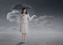 Businesswoman holding an umbrella Royalty Free Stock Photography