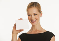 Businesswoman holding up blank card for copy space Royalty Free Stock Photo