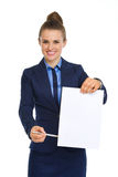 Businesswoman holding up blank paper, pointing with pen Royalty Free Stock Photo