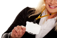 Businesswoman holding up her blank ID tag Royalty Free Stock Photography