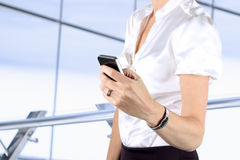 Businesswoman holding  and using the mobile   phone Stock Photos
