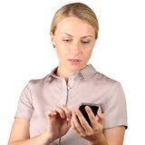 Businesswoman holding and using the mobile smart  phone on a Royalty Free Stock Image
