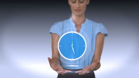 Businesswoman holding virtual alarm clock. On grey background stock footage
