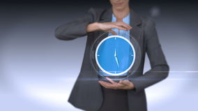 Businesswoman holding virtual alarm clock. On grey background stock video