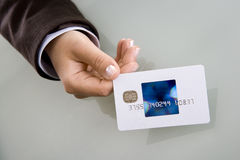 Businesswoman holding visa credit card Royalty Free Stock Photography