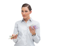 Businesswoman holding wads of cash Stock Images