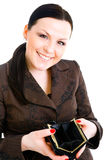 Businesswoman holding wallet over white Stock Image
