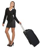 Businesswoman holding wheeled bag in moving Royalty Free Stock Photo