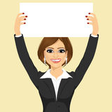 Businesswoman holding white blank board Stock Photography