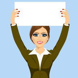 Businesswoman holding white blank board Royalty Free Stock Images
