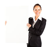 Businesswoman holding white board Royalty Free Stock Images