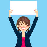 Businesswoman Holding White Board. Pretty businesswoman holding white blank board over blue background Royalty Free Stock Image