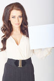 Businesswoman holding a white board Royalty Free Stock Photography