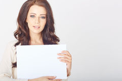 Businesswoman holding a white board Stock Image