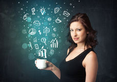 Businesswoman holding a white cup with business icons Royalty Free Stock Photography