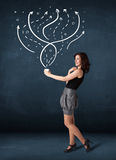 Businesswoman holding a white cup with lines and arrows Royalty Free Stock Photo