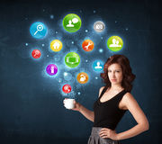 Businesswoman holding a white cup with setting icons Royalty Free Stock Photo