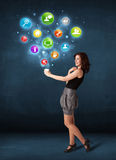 Businesswoman holding a white cup with setting icons Stock Images