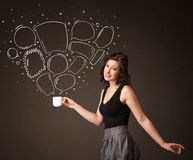 Businesswoman holding a white cup with speech bubbles Royalty Free Stock Image