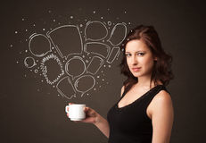 Businesswoman holding a white cup with speech bubbles Stock Image