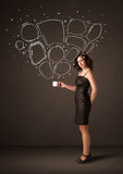 Businesswoman holding a white cup with speech bubbles Royalty Free Stock Photo