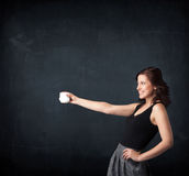 Businesswoman holding a white cup Royalty Free Stock Photos